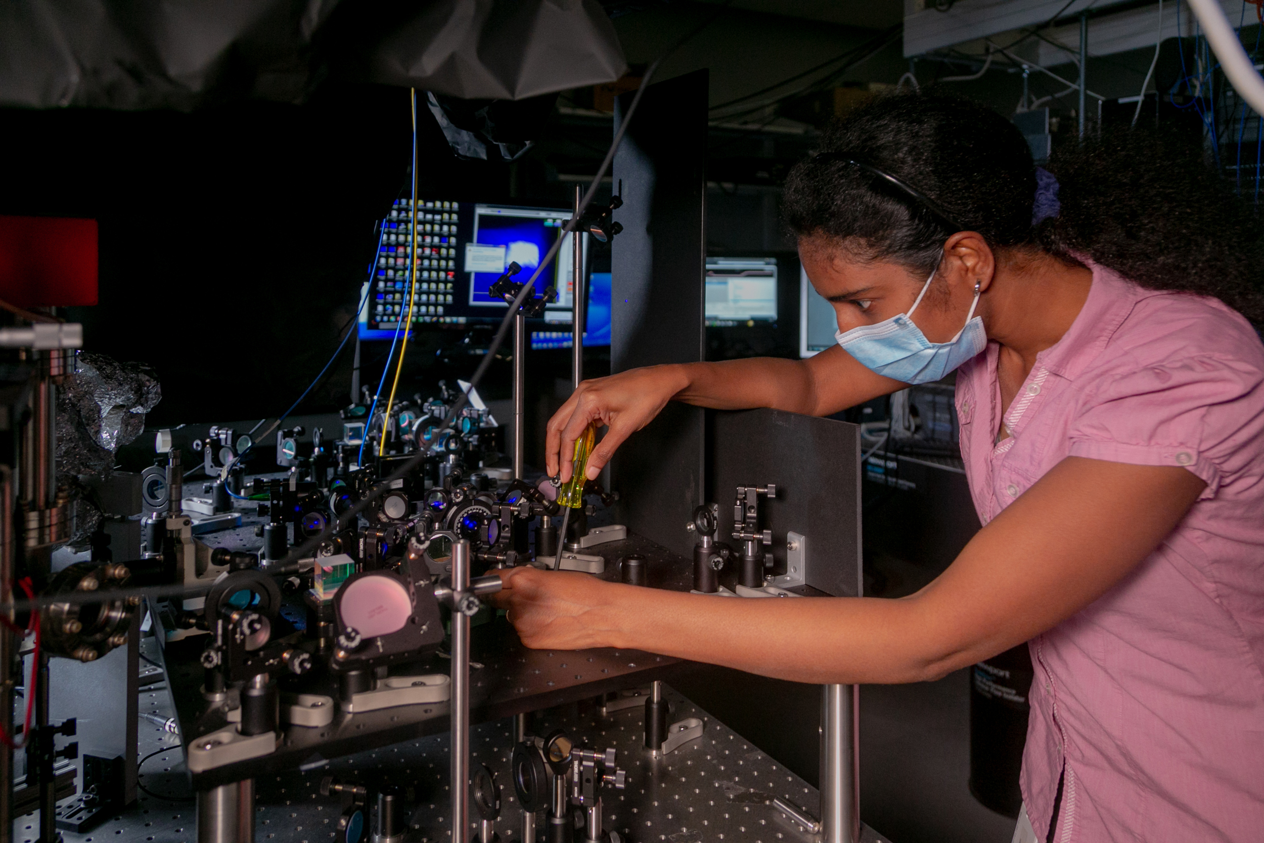 Jyothi Saraladevi, a Postdoctoral Associate in the Brown Lab works on a quantum computer setup.
